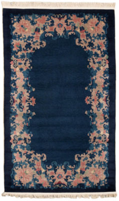Hand knotted in eastern China ca. 1920 using 100% wool. This antique Chinese rug is in very good condition and will bring a vintage style to wherever it lands.